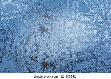 Frosty natural pattern on winter window close-up