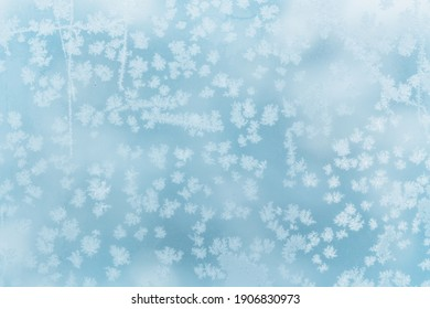frosty pattern on glass, snow crystals background