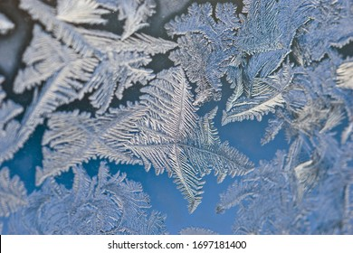 Frosty patterns on the glass. Blue frost texture drawing
