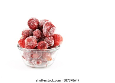 Frosty strawberries in a glass container