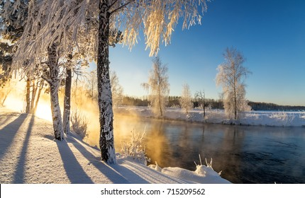 frosty winter morning landscape with mist and forest river, Russia, Ural, January