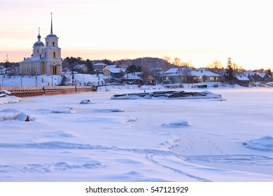 Frosty winter morning in the northern village. Karelia, Russia