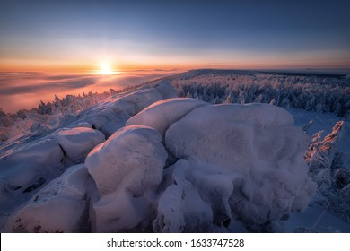 Frosty Сliffs. Winter snow covered mountain peaks at sunset.