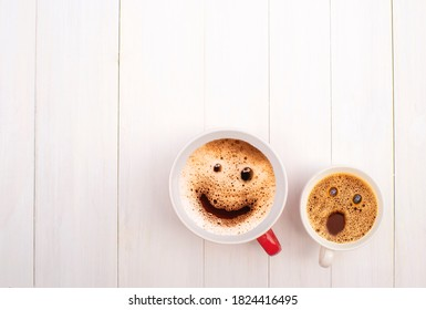 froth milk foam smiles in a cup of coffee in morning.
