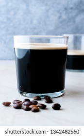 Frothy Cold Brew Nitro Coffee with Beans Ready to Drink. Organic Beverage with Caffeine
