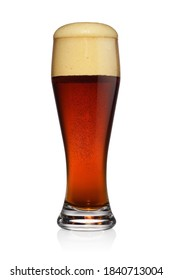 Frothy glass of brown dark beer isolated on a white background