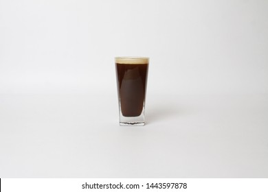 Frothy Nitro coffee isolated on white with copy space.