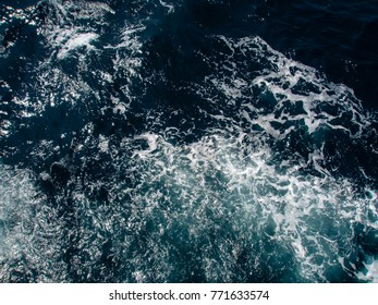 Frothy sea waves
