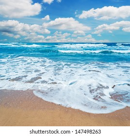 frothy shore and scenic clouds in Sardinia