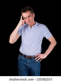 Frowning Confused Middle Age Man Scratching Head in Thought Black Background