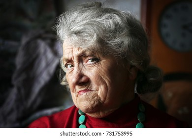 Frowning and sad grandmother face