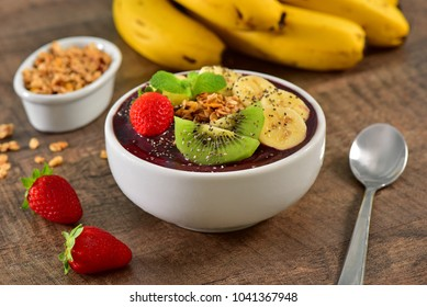 Frozen acai berry bowl with fruits on top
