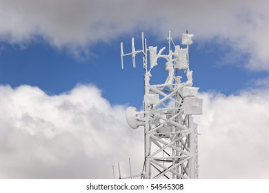 Frozen antenna over a cloudy sky
