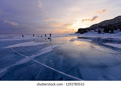 Frozen Baikal Lake in Olkhon Island, Russia with silhouette of photographers.Beautiful landscape with blue sky.Dream destination for travellers.Famous place with backpackers.Copy Space for design work