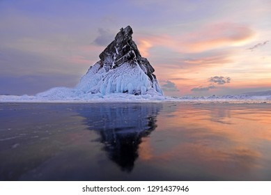 Frozen Baikal Lake with rock mountain in Olkhon Island, Russia. Beautiful winter landscape during sunset.Dream destination for travellers.Nature famous place with backpacker.Copy space for design work