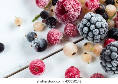 frozen berries: black currant, red currant, blackberry, blueberry, white currant. top view, macro.