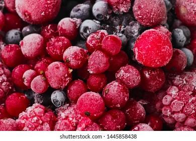 Frozen berries closeup. Cherries, currants, blueberries, blackberries