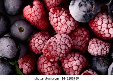 Frozen berries closeup, top view shot.