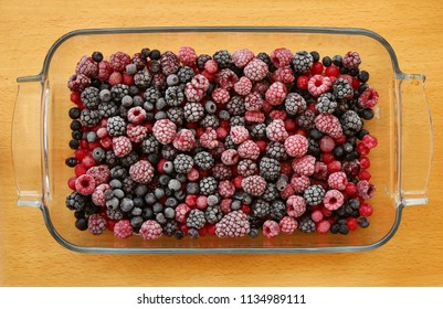 frozen berries in a glas bowl may used as background