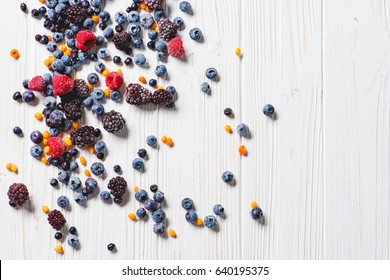 Frozen berries on white background overhead shot