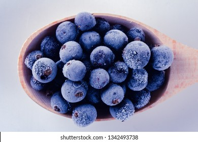 Frozen berry food and blueberry delicious dessert in spoon,  cream.