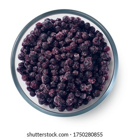 Frozen blueberries in a glass plate on a white background. Isolated frozen berries. Top view