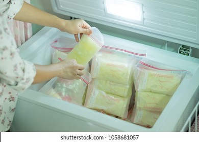 Frozen breast milk storage bags in refrigerator., Mother breast milk is the most healthy food for baby. Storage bags for new baby.  selective focus.