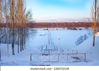 Frozen bridge in winter. Parking for boats