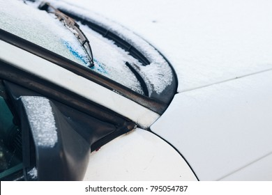 Frozen car on the road. Close up.