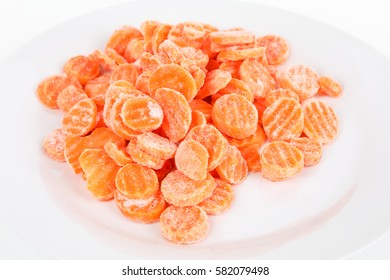 Frozen carrots on a plate with white background