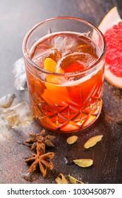 Frozen Citrus cocktail on dark background