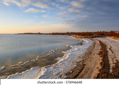 Frozen coastline in Jastarnia at sunset time. Baltic Sea. Poland.