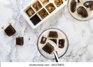 frozen coffee cubes with milk - cocktails on marble table