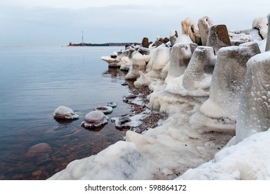 frozen countryside scene in winter with snow. beach scene with ice blocks