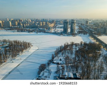 The frozen Dnieper river in Kiev. Aerial drone view. Winter sunny frosty morning.