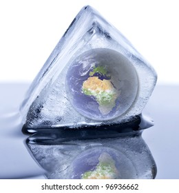 """Frozen earth globe inside the ice cube. """"Elements of this image furnished by NASA"""""""