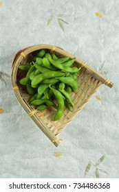 Frozen edamame beans in the basket on washi (Japanese paper). ready to serve at Japanese restaurant in Bangkok, Thailand.