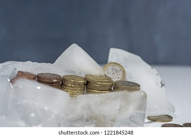 Frozen euro coins in ice. Abstract photo in banking.