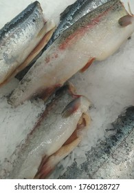 Frozen fish for sale to people in a supermarket in a metropolis
