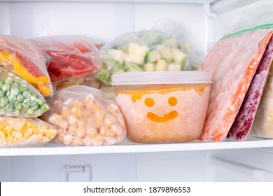 Frozen food in the freezer. Frozen vegetables, soup, ready meals in the freezer