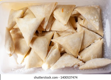 Frozen food in the refrigerator. Frozen samosa in the box. Preparing for Ramadan - Image