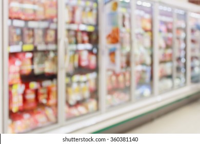 Frozen food section in supermarket blurred background