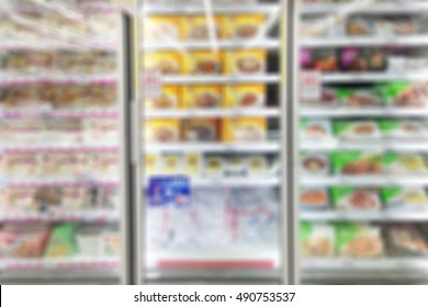 Frozen food section in supermarket blurred background.