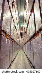 Frozen food at shelves in cold warehouse