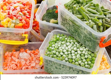 Frozen foods recipes vegetables in plastic containers. Healthy freezer food and meals.