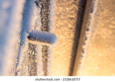 frozen frost on the metal elements of the garage door and lock in extreme cold, the front and rear background is blurred with the effect of bokeh