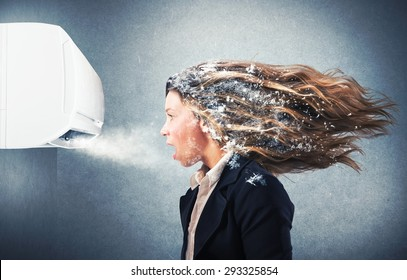 Frozen girl under a powerful air conditioner