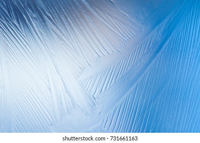 Frozen glass. Abstract winter ice pattern on frozen window.