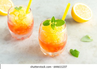 Frozen Granita Wine Slush Drink on rustic stone table. Homemade Italian Granita Dessert, refreshing  summer Gradient Slush Drink with mint.