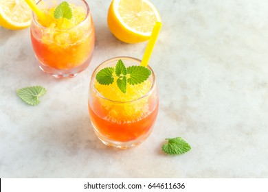 Frozen Granita Wine Slush Drink on rustic stone table. Homemade Italian Granita Dessert, refreshing  summer Gradient Tropical Slush Drink with mint.